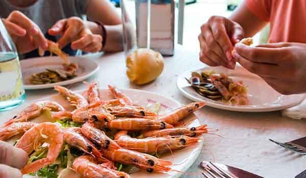People eating seafood