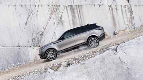 2018 Land Rover Range Rover Velar driving down dirt hill