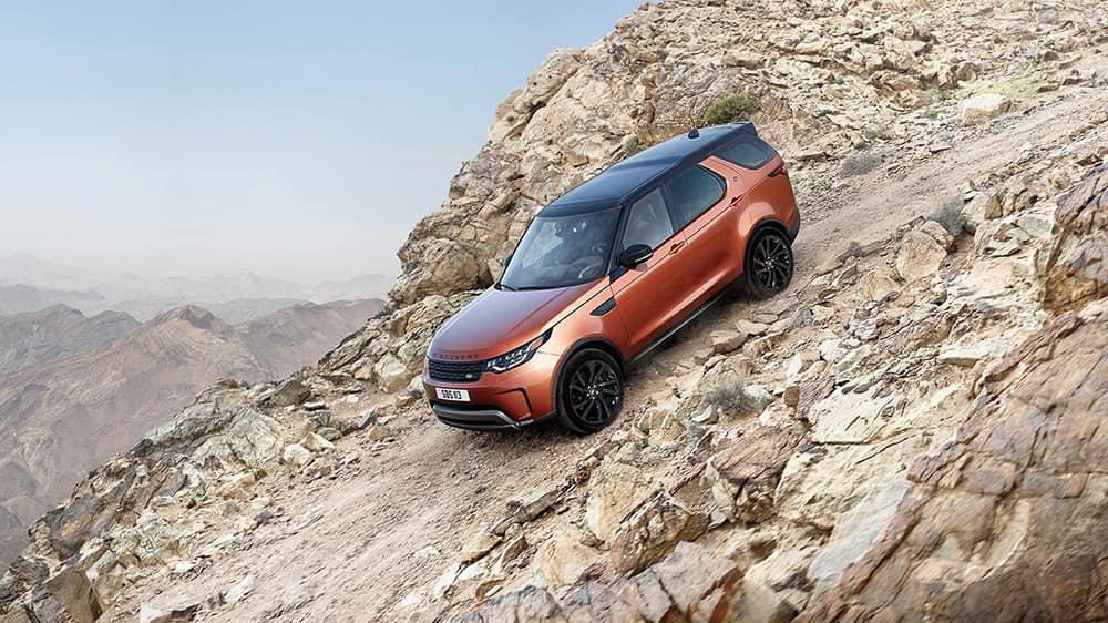 2019 Land Rover Discovery Off-Roading Down a Rock Mountain