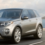 2019 Land Rover Discovery Sport SUV driving on coastal road