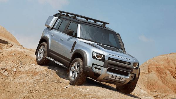 Land Rover Defender off-roading on rocky terrain