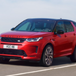 The 2021 Land Rover Discovery Sport driving on a highway.