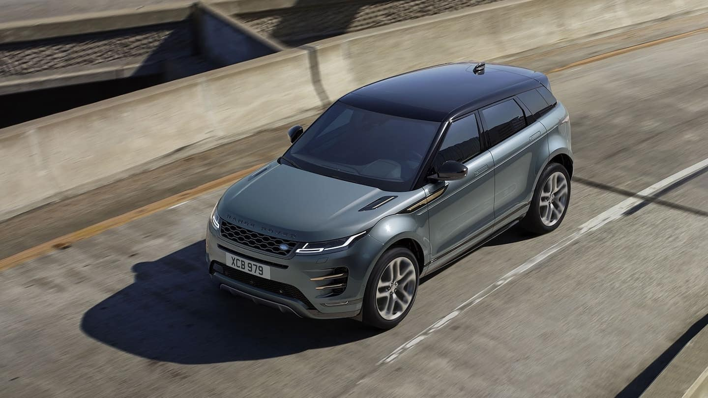 The 2021 Range Rover Evoque driving on a highway near Merrick.
