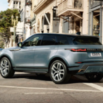 The 2021 Range Rover Evoque making a turn in a city.