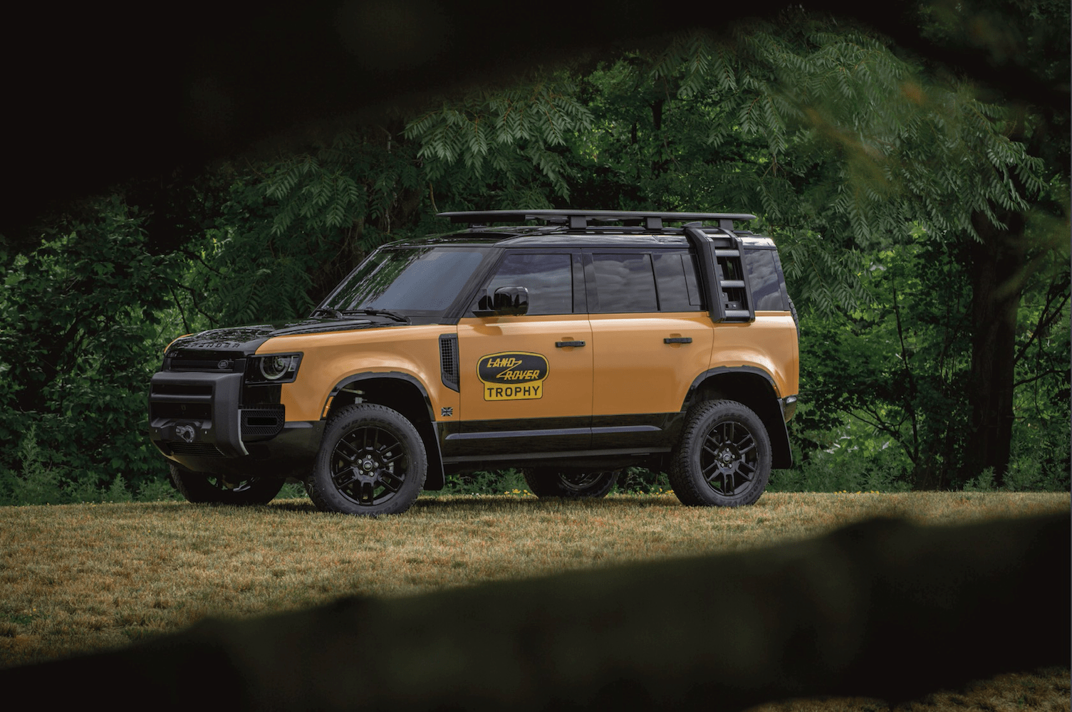 2022 Land Rover Defender Trophy parked in wooded area