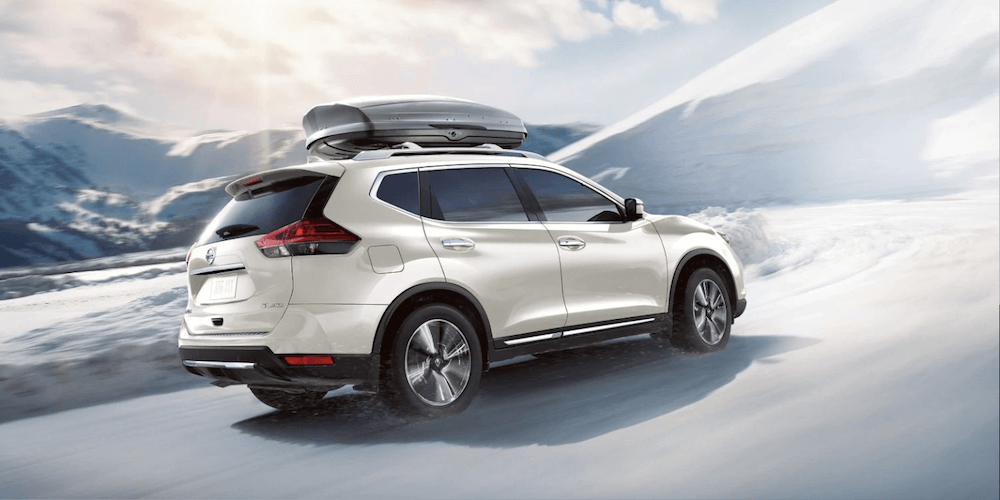 2019 Nissan Rogue white SUV in snow