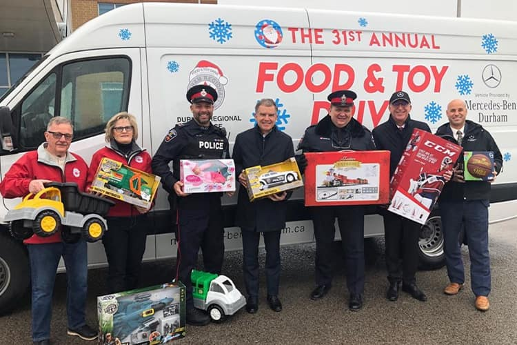 Neal with Police for the toy drive