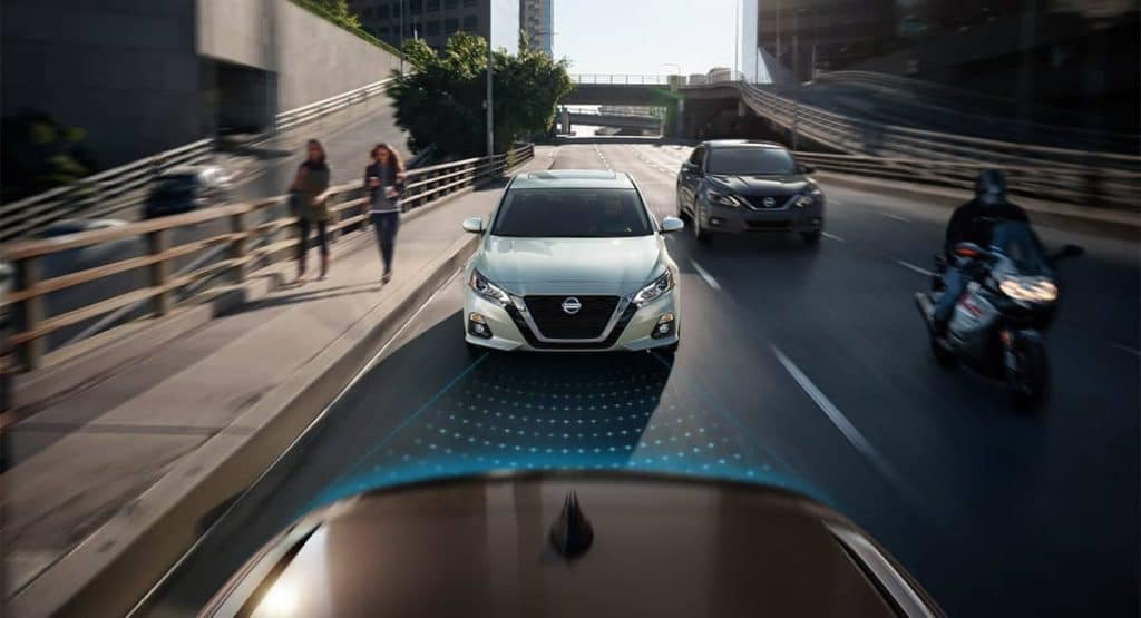 2019 Nissan Altima driving down the street