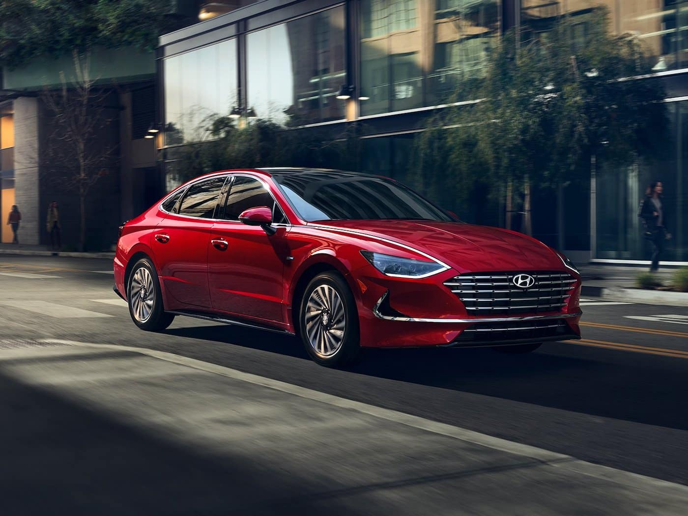 The 2021 Hyundai Sonata Hybrid driving down the street.