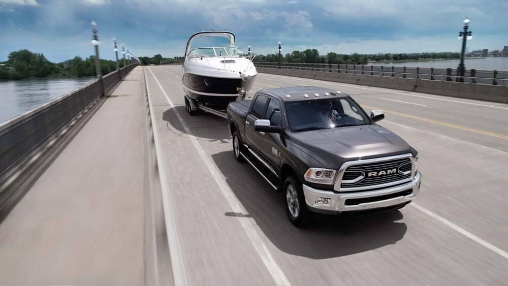 2018 Ram 2500 Limited tows boat on highway