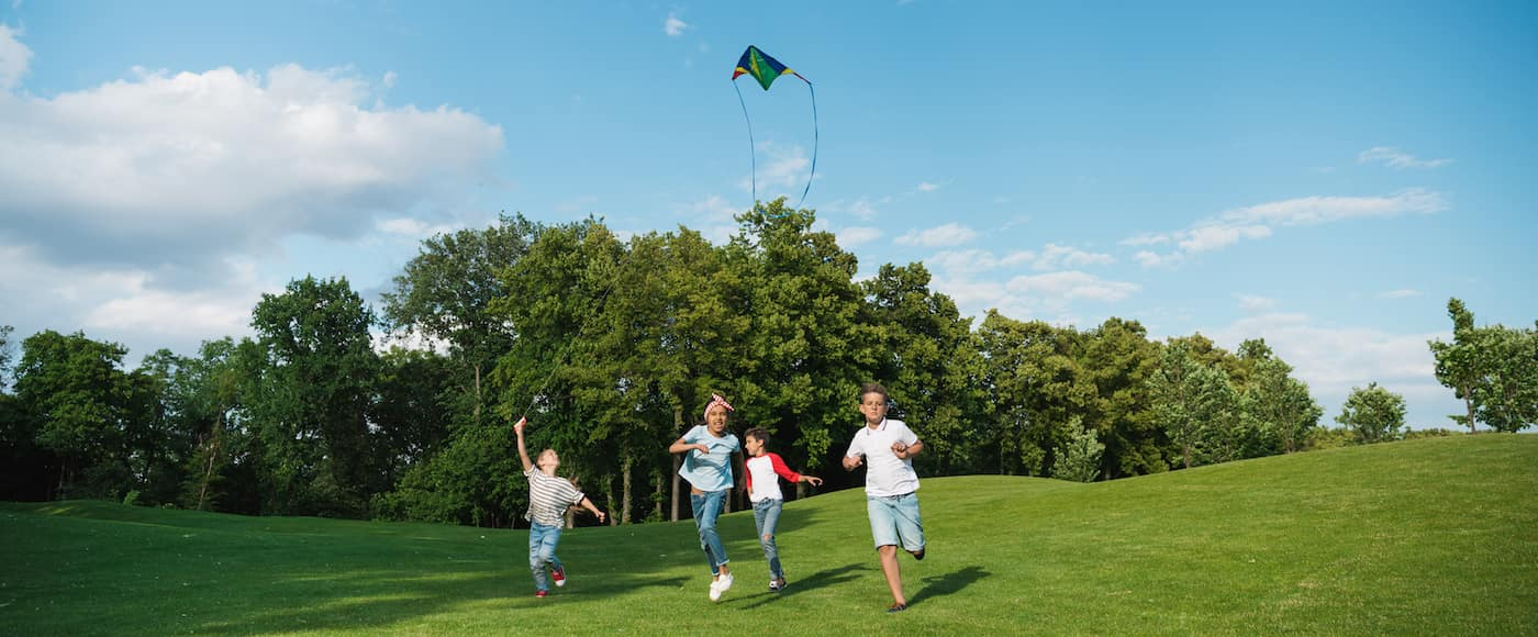 Children flying a kite in the park