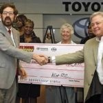 Palmer's Toyota giving donation check to Child Advocacy Center