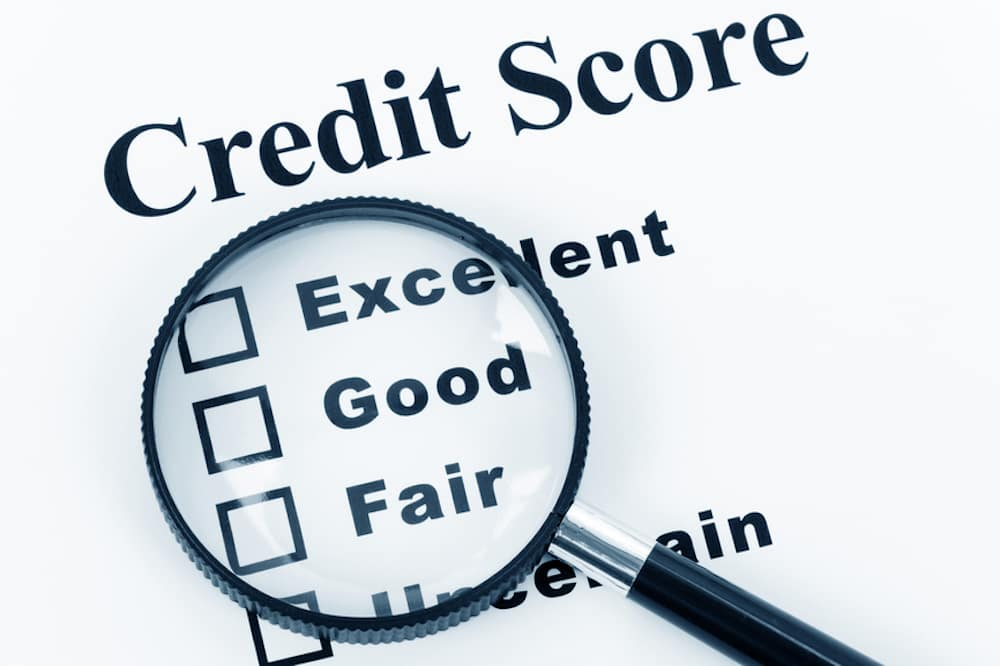 Magnifying glass examining credit score