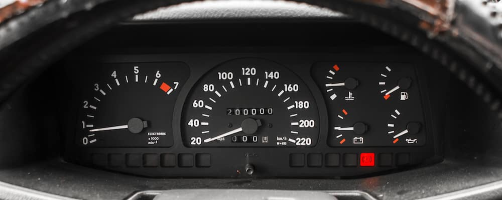 Vintage vehicle dashboard showing odometer, speedometer, fuel levels