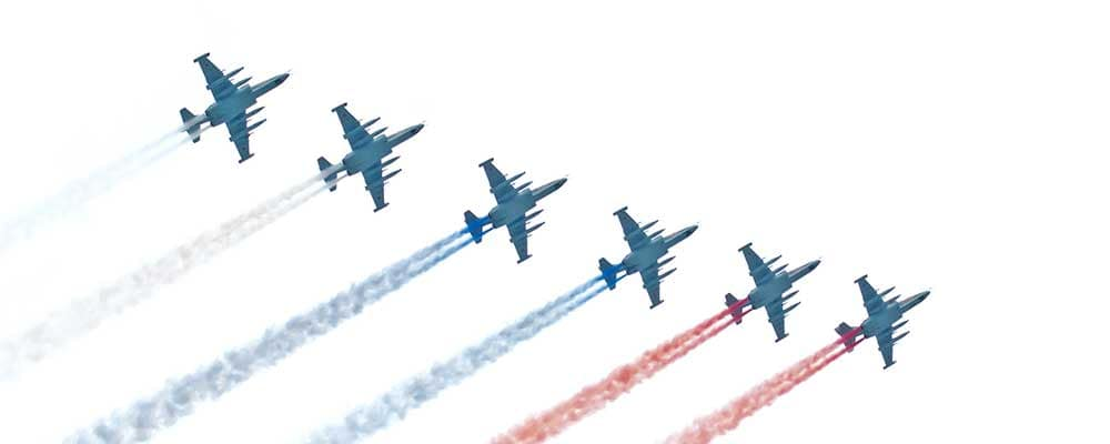 air force jets with red white and blue smoke