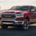 Red RAM 1500 on a dusty southwestern ranch