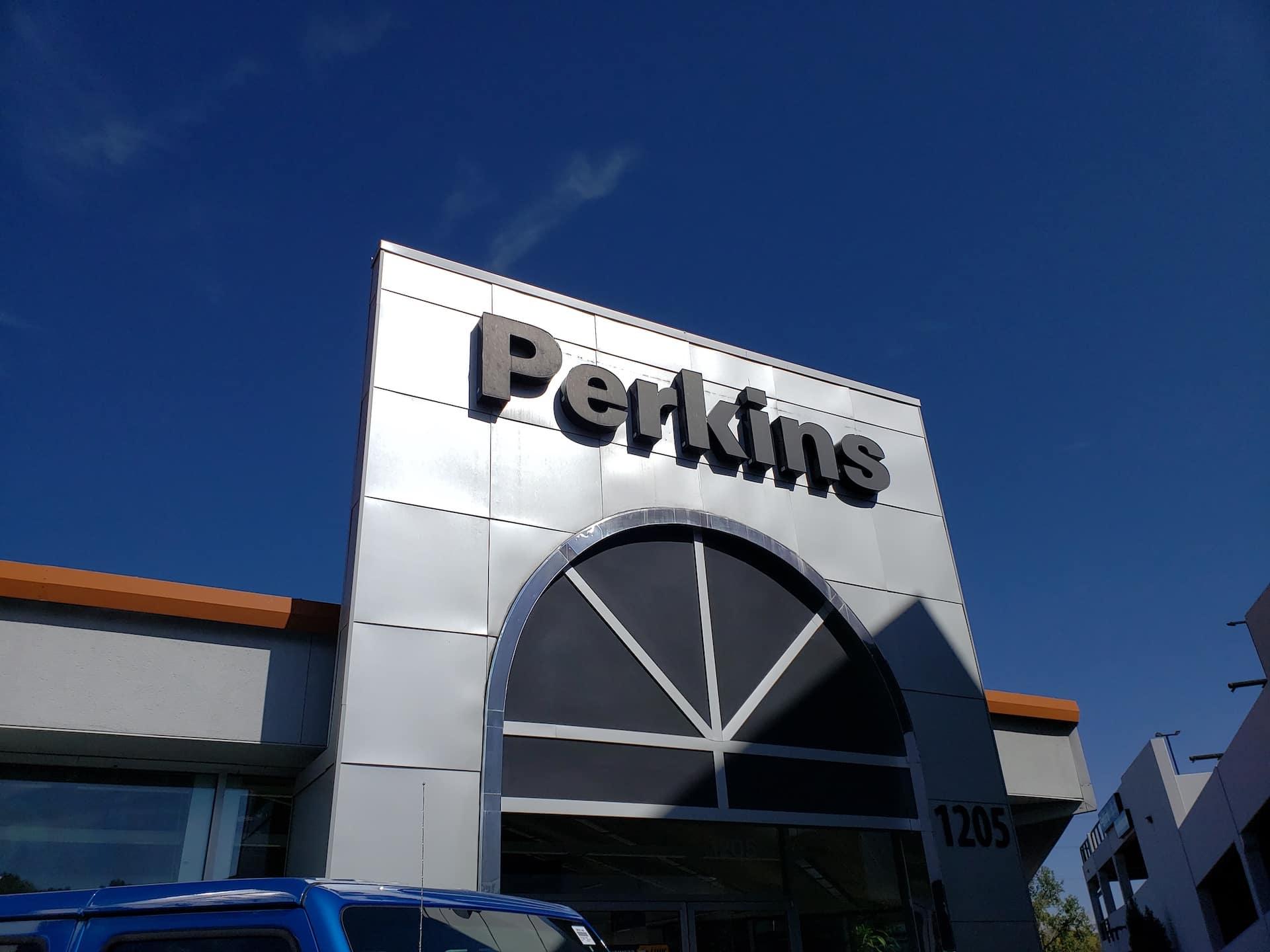 front of dealership modern-day