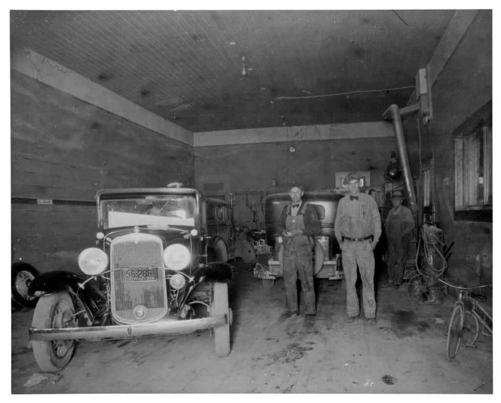 2 men by old car