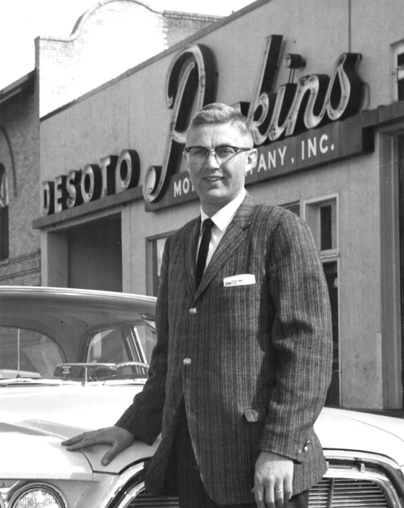 guy in glasses by car