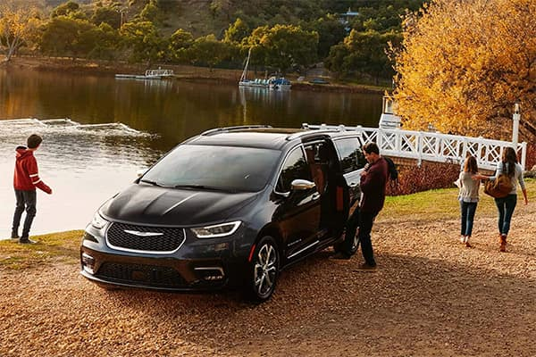 Family exiting Chrysler Pacifica Hybrid