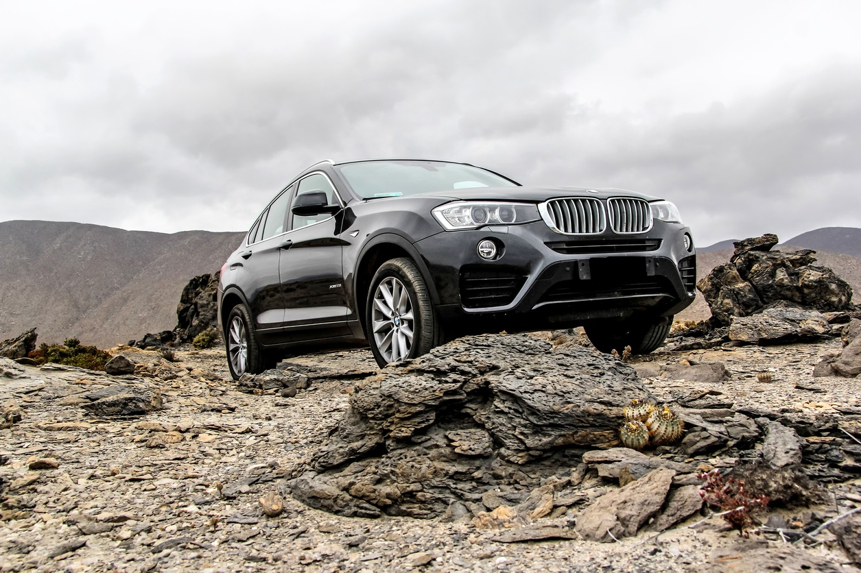 New black crossover BMW F26 X4 is parked at the stone desert.