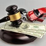 a photo symbolizing car auction sales with toy cars and a gavel