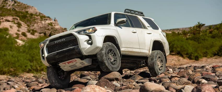 White 2019 Toyota 4Runner offroading over rocks