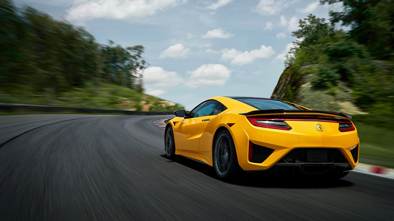 2020 Acura NSX Exterior Indy Yellow Pearl Rear Angle Driver Side