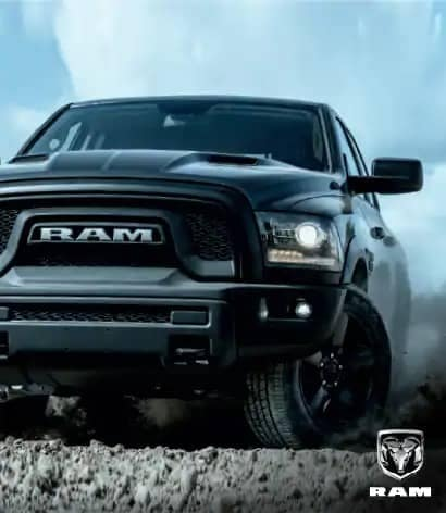 black ram truck parked on dirt