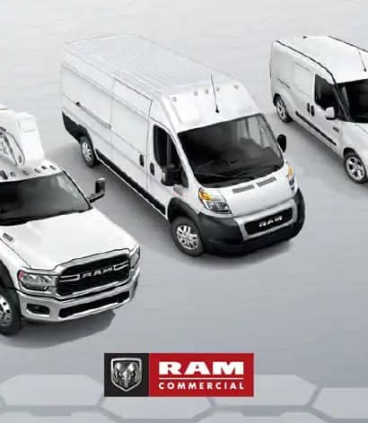 white ram commercial vehicles parked in a row