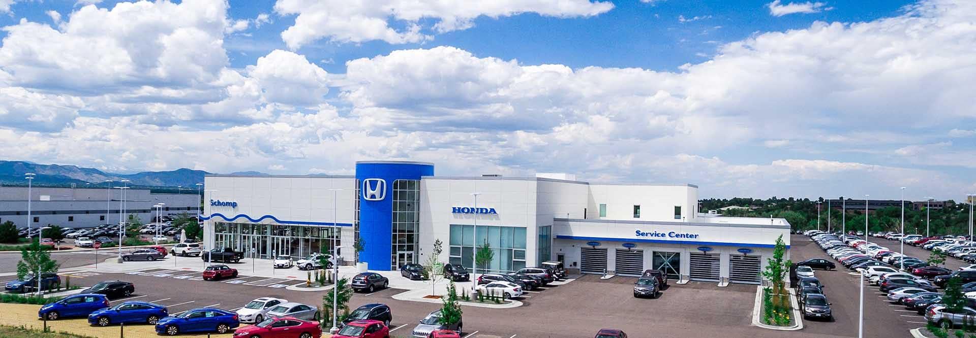 An exterior shot of a Honda dealership at night.
