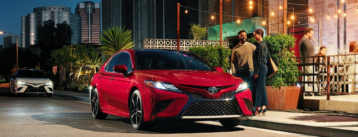 Red 2019 Toyota Camry parked curbside