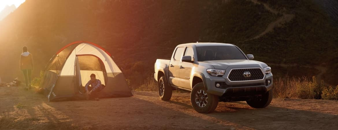 2019 Toyota Tacoma parked next to camping tent