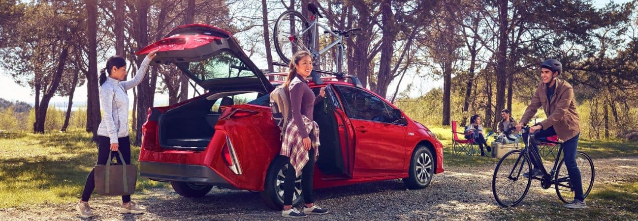 2020 toyota prius prime parked near a camp site