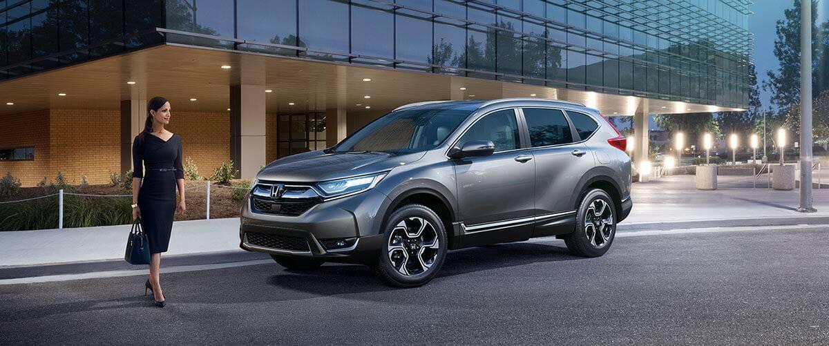 2017-cr-v--ext-34-front-driver-lady-with-car-1400-1x