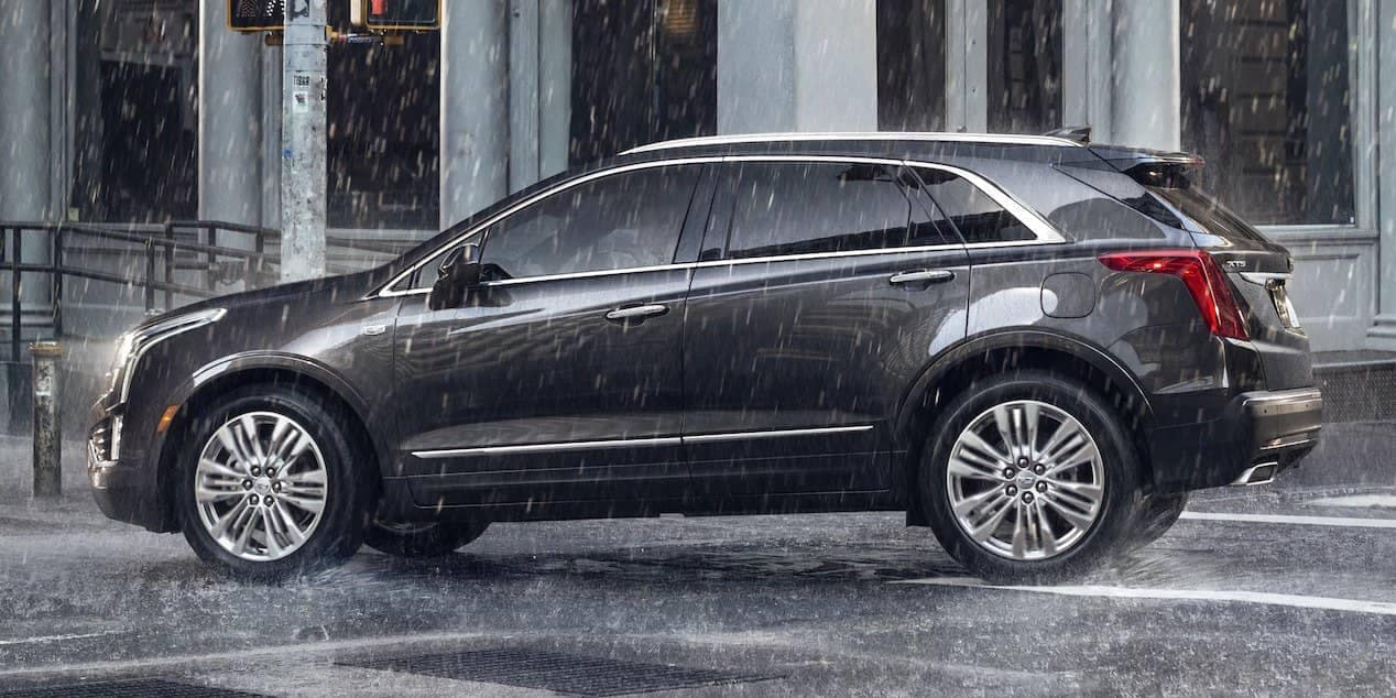 black 2018 Cadillac XT5 in the rain