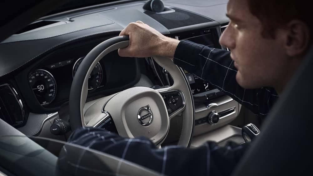 driver behind the wheel of 2019 Volvo XC60