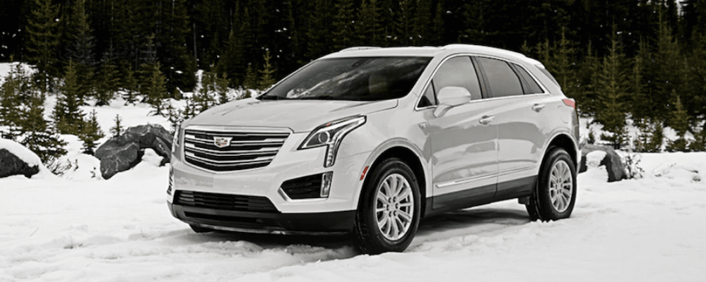 2019 Cadillac XT5 driving through snow.