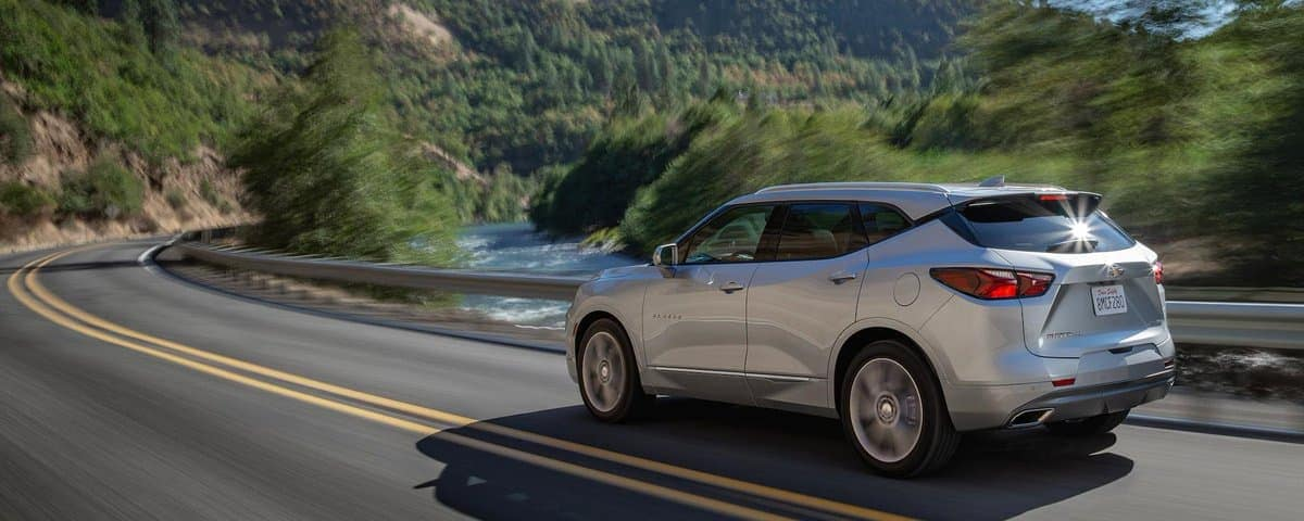 2019 Chevy Blazer in silver driving down road