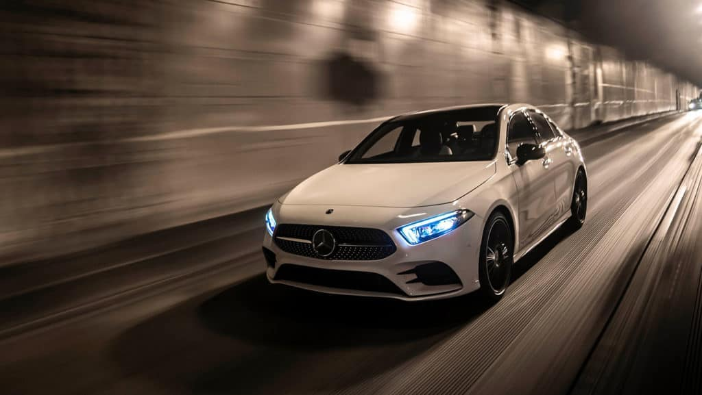2019 MB A-Class in white performance driving down road