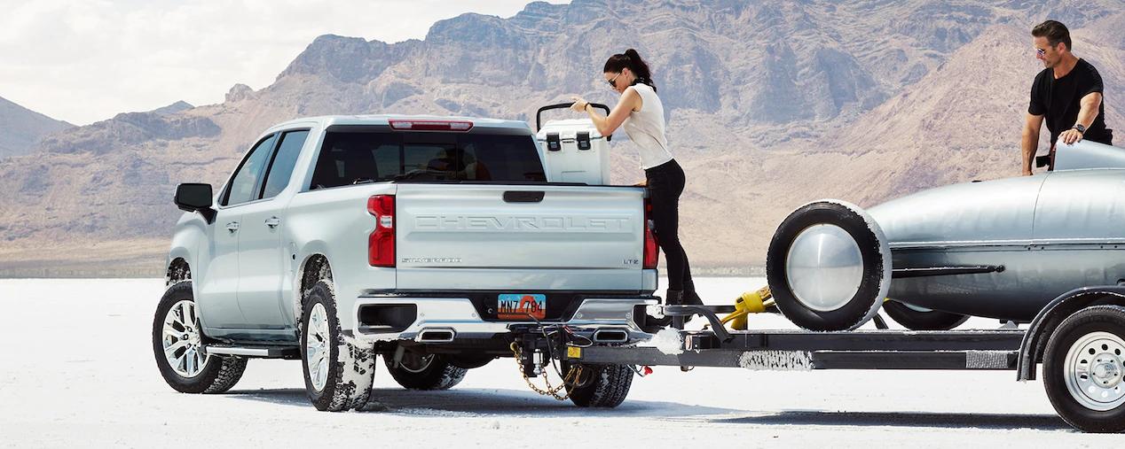 2019 Chevrolet Silverado towing a race car