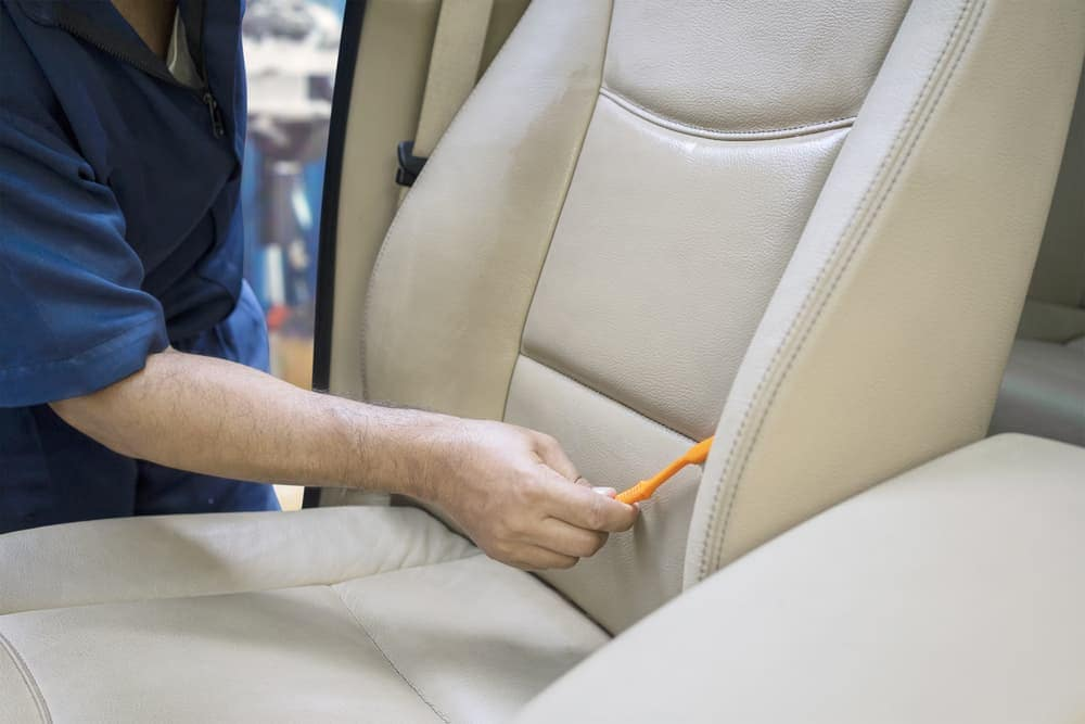 Gently brushing leather car seat