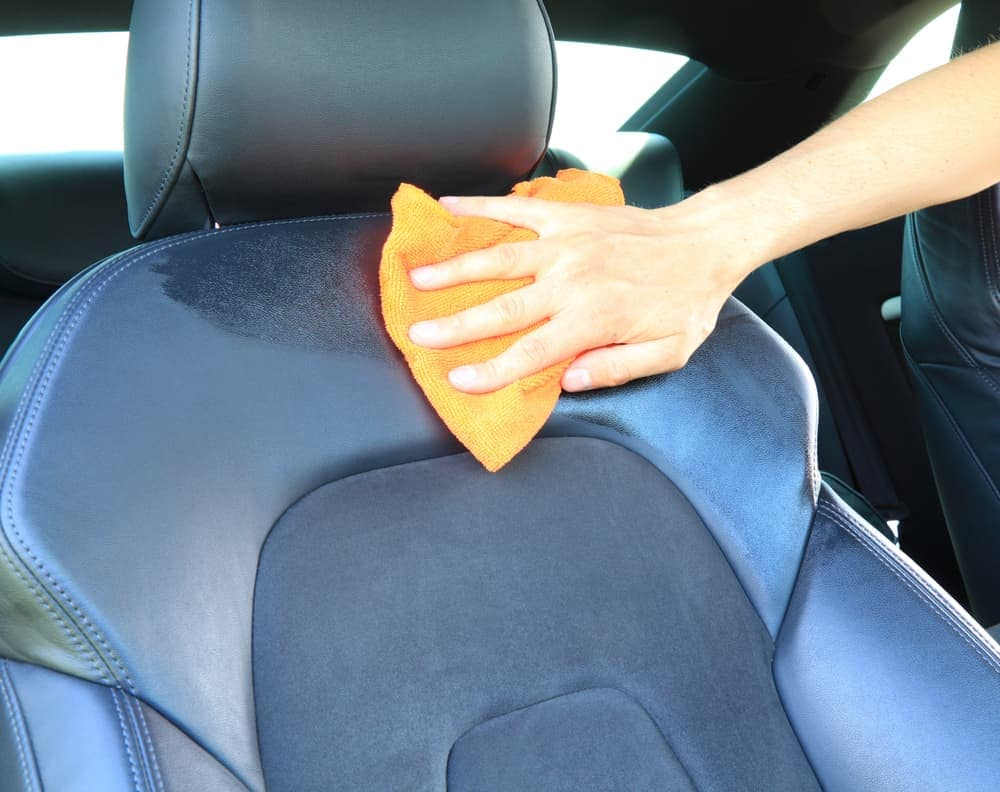 Wiping down leather car seat