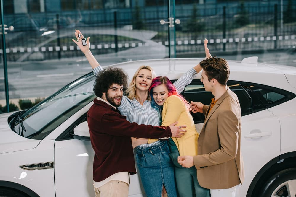 Friends excited for woman buying car