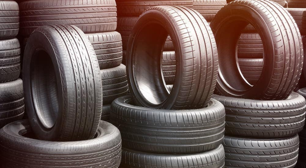 Stacks of tires are shown at a local tire shop.