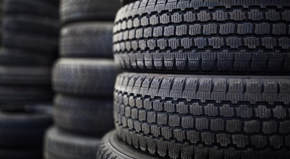 Stacks of new tires are shown.