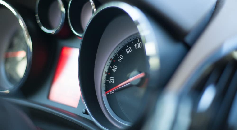 A gauge cluster in a vehicle is shown from an angle.