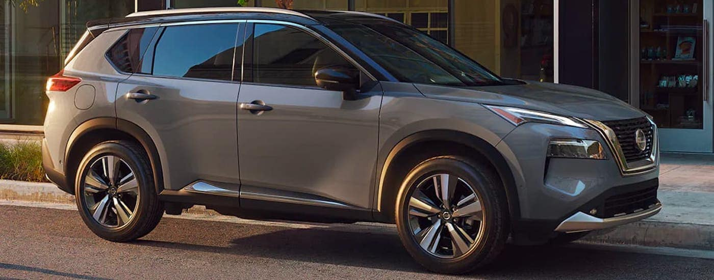 A gray 2021 Nissan Rogue is parked on a city street after leaving a Joliet car dealership.