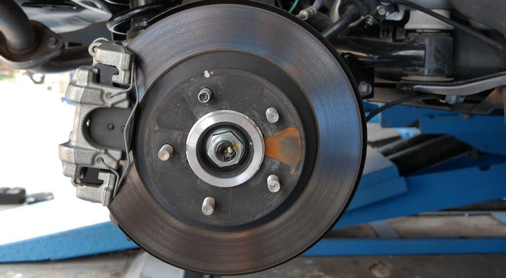 A closeup shows a brake drum on a car.
