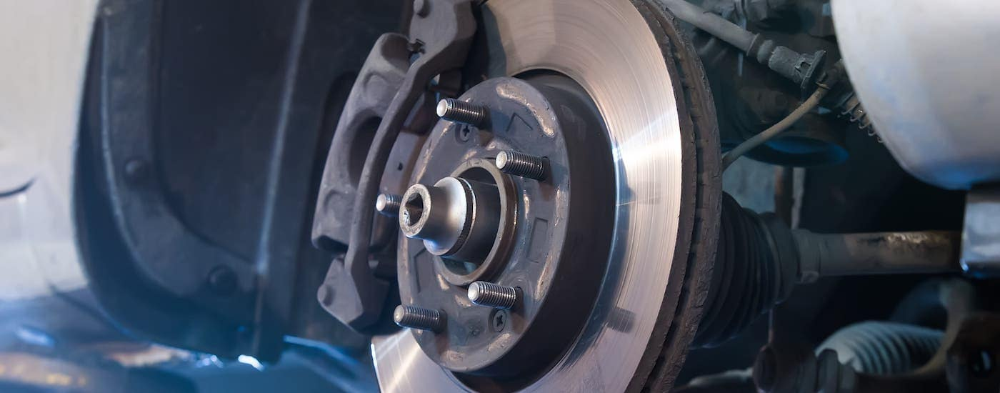 A closeup shows a brake drum during a brake service.